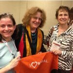 Attendees at the COF rural philanthropy gathering pose with a Love Rural bandanna.