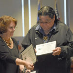 Colleen Landkamer, USDA Rural Development State Director, (left) hands certificates to Darrell G. Seki Sr., Red Lake Chairman (middle) and Annette Johnson, Red Lake Treasurer Thursday following a press conference at Red Lake Government Center.