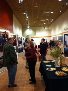 Community members gather at Why Treaties Matter exhibit at the Edge Center in Bigfork